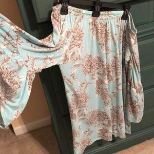 Off the shoulder tunic top with floral pattern